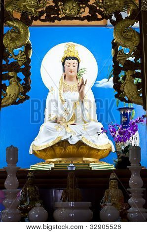 Quan Yin statue on altar in Chinese temple. poster