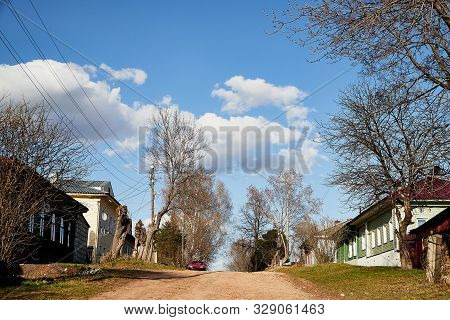 Tipical Russian Village With Old House In A Summer Or Spring Day