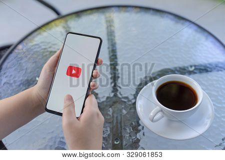 Chiang Mai, Thailand - Oct.18,2019: Woman Holding Xiaomi Mi Mix 3 With Youtube Apps On Screen. Youtu