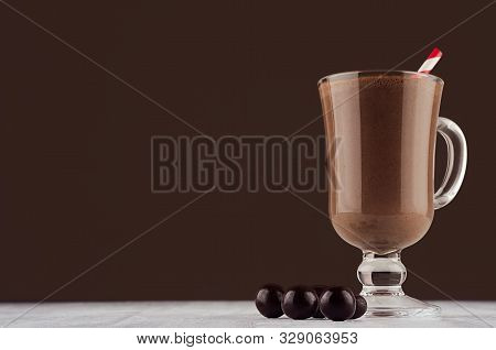 Christmas Beverage - Hot Chocolate With Round Chocolates And Red Striped Straw  In Elegant Dark Brow