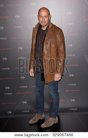 NEW YORK - OCT 19: Designer John Varvatos attends the launch of their