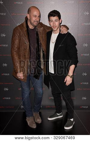 NEW YORK - OCT 19: Designer John Varvatos (L) and singer Nick Jonas attend the launch of their