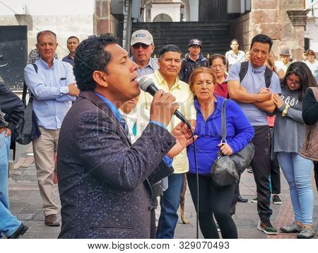Quito, Ecuador, September 29, 2019: Local Singer At The Historic Centre Of Quito, Ecuador. Proclaime