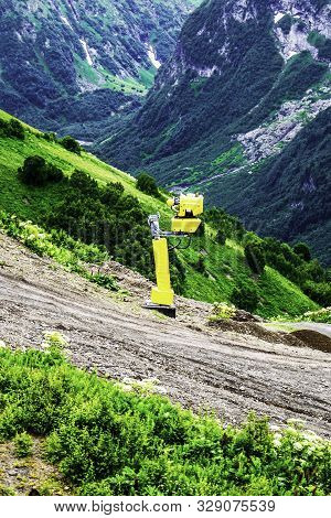 Machine For Making Snow Stands On A Mountainside In A Summer