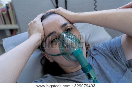 Sick Woman With Oxygen Mask In Emergency Room At Hospital