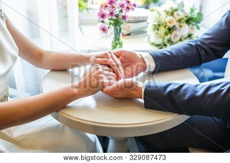 Romantic Couple Holding Hands. Lovers Or Newlywed Married Young Couple In Romance. Wedding Theme