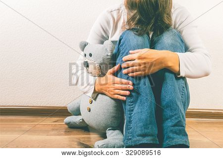 Prenatal Loss Concept - Depressed Woman Holding Teddy Bear Toy, Copy Space
