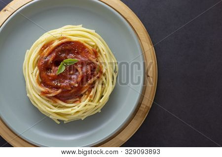 Spaghetti Pasta Bolognaise With Tomatoes Sauce And Basil In Plate On Dark Background. Pasta Plate Is