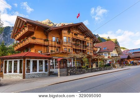 Kandersteg, Switzerland - October 17, 2019: Street View With Colorful Wooden House, Swiss Flag And M