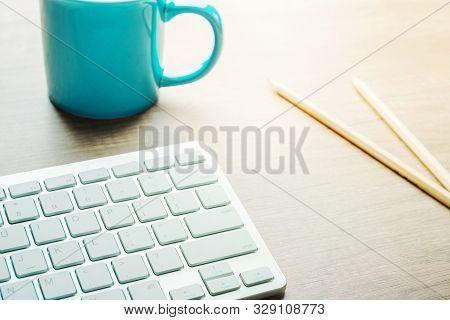 Blue Mug With Coffee Tea White Computer Keyboard Pencils On Wood Desk. Designer Copywriter Student F