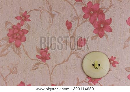 old wallpaper with light switch