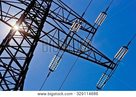 power line with sun and sky