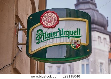 BRNO, CZECH REPUBLIC - April 14, 2018: Pilsner Urquell brewery sign on a pub in Brno, famous czech beer