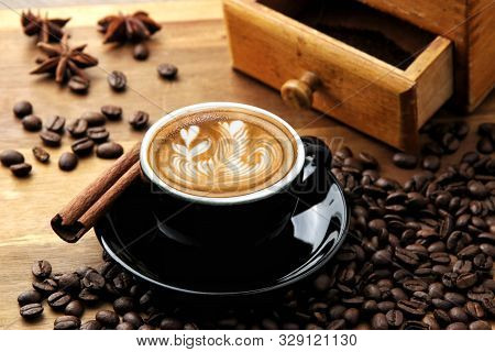Love Coffee In Black Coffee Cup, Latte Art Coffee Cup And Roast Beans And Star Anise And Cinnamon On