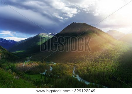 Mountain River Valley Landscape. A Mountain Massif In The Sunset Rays.