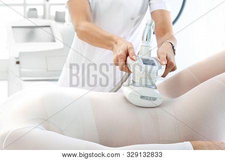 Vacuum Massage. Endermology, Abdominal Vacuum Massage. A Womans Body During A Care Treatment