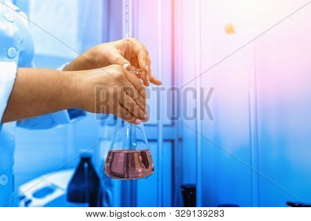 Laboratory Beaker In Test, Chemical Reaction. Lab Worker Checks Purified Drinking Water For Impuriti