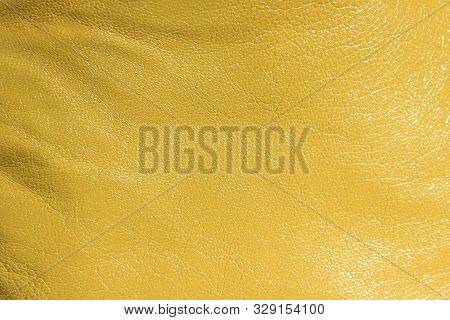 Blurred Leather Background, Ocher Color. Abstract Texture Background Out Of Focus. Abstract Light-br