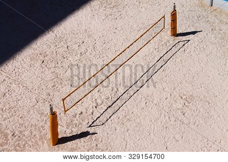 Sandy Beach Volley Field With Yellow Net