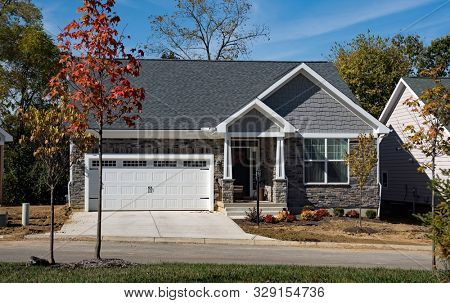 Newly Built Upscale Stone Home in Fall