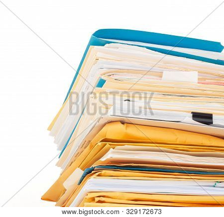 Looking Up At An Intimidating Stack Of Well Worn File Folders, Manilla Envelopes, And Papers Isolate