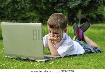 Young Boy Working On Laptop