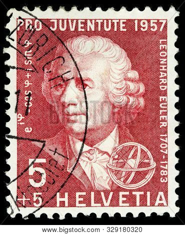 Luga, Russia - October 15, 2019: A Stamp Printed By Switzerland Shows Swiss Physicist, Mathematician