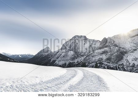 Sunny Winter Scenery With Snow-capped Mountains Peaks, Snow-covered Nature, And Snowy Alpine Road, N