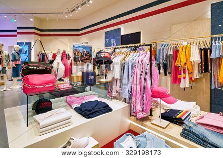 SHENZHEN, CHINA - CIRCA APRIL, 2019: interior shot of Tommy Jeans clothes shop at a shopping mall in Shenzhen.