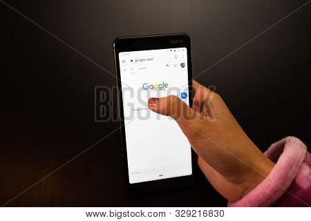 Woman Holding A Nokia Phone With Google Internet Service On The Screen In Bucharest, Romania, 2019