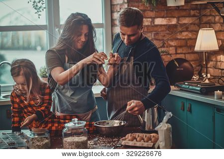 Friendly Positive Family Spending Morning At The Kitchen, They Are Cooking Breakfast.