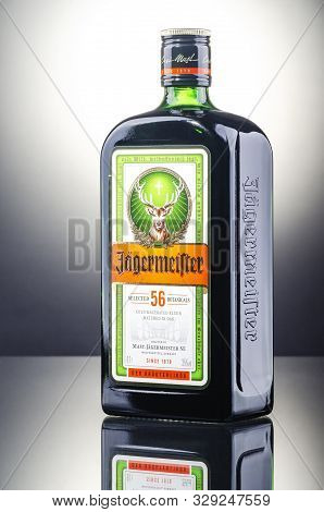 Jagermeister Digestif On Gradient Background. Jagermeister Made With 56 Herbs And Spices. It Is Manu