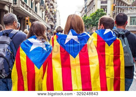 Barcelona, Spain - October 18, 2019: A People With Catalan Flags Walking On The Streets During Prote