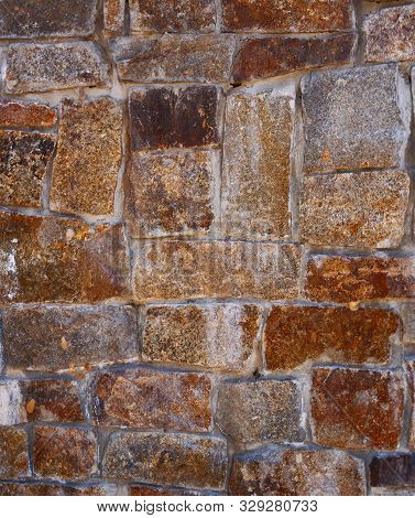 Background Texture Of Natural Stone. Rough And Rusty. Wall, Close-up, Macro Photography.