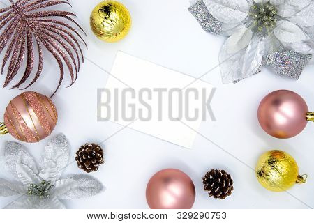 Christmas Ornament And Blank Paper On White. Winter Holiday Photo Background With Fir Tree Baubles.