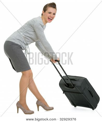 Tired traveling woman hauling suitcase isolated on white poster