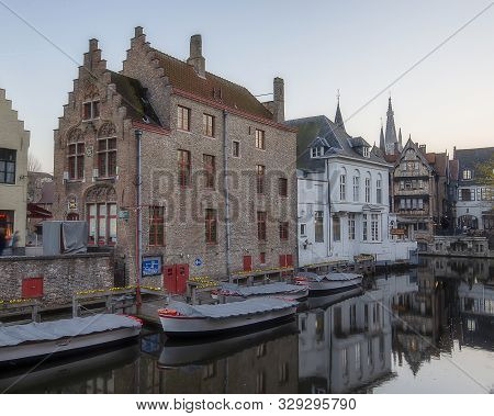 The Boats At The Greenery Canal In The Historic Center Of Bruges, Belgium