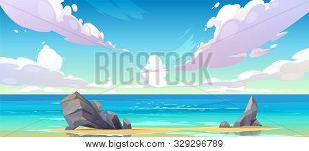Ocean Or Sea Beach Nature Landscape With Fluffy Clouds Flying In Sky And Rocks Sticking Up From Sand