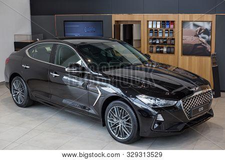 Russia, Izhevsk - October 10, 2019: New Modern Genesis G70 In The Hyundai Showroom.