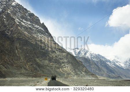 Indian Driving Car On Khardung La Road In Himalaya Mountain Bring Travelers Visit Nubra And Pangong