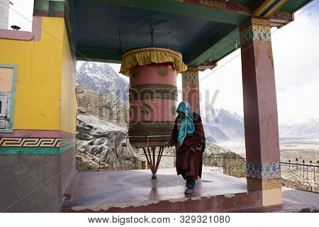 Jammu Kashmir, India - March 21 : Tibetan Praying And Rite Rotate And Spin Prayer Wheels In Diskit M