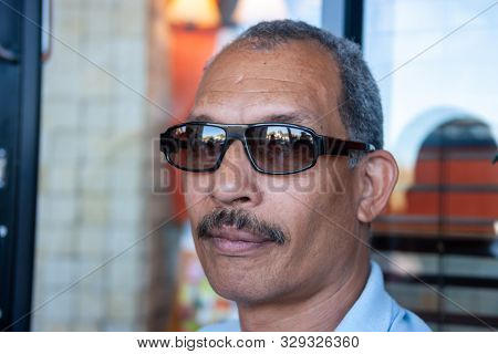 Relaxed latino cuban businessman in a coffeeshop in a mall