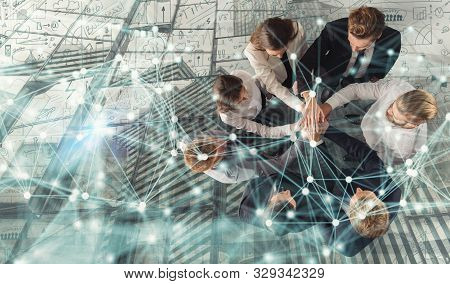 Handshaking Business Person In Office. Concept Of Teamwork And Partnership. Double Exposure With Net