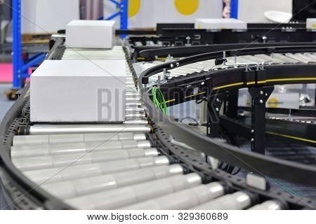 Cardboard Boxes On Conveyor Belt.parcels Transportation System Concept
