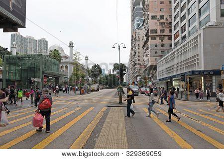 Kowloon, Hong Kong - April 23, 2017: Pedestrian Crossing Nathan Road At Tsim Sha Tsui, Hong Kong, Ch
