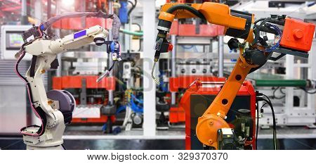 Orange Robotic And White Robotic Hand Machine Tool System In Factory, Industry Robot Concept