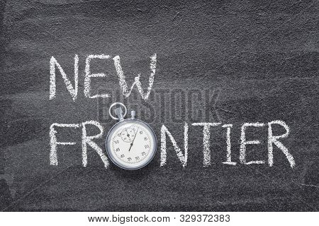 New Frontier Phrase Written On Chalkboard With Vintage Precise Stopwatch