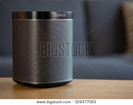 Uk, October 2019: Sonos Play Black Wireless Speaker On Wooden Table In Lounge