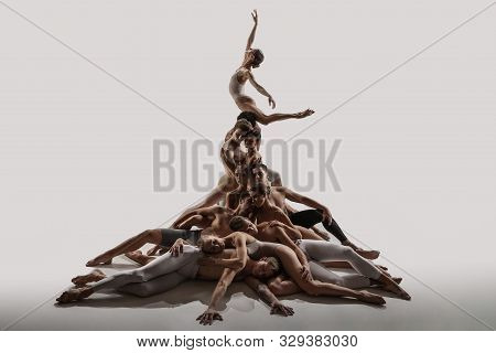 The Group Of Modern Ballet Dancers. Contemporary Art Ballet. Young Flexible Athletic Men And Women I