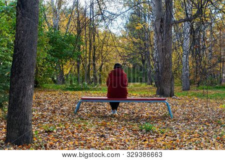 A Depressed And Sad Woman And An Old Lady On A Bench In An Autumn Park. The Concept Of The Need To H